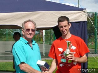 Blue Walshe presents to Tommy Brister 10k First Shepton resident